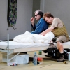 Claus Guth's stage direction at Hamburg State Opera (2009) shows Mime (left) in bed  with headache tablets and water within reach. Photo: Monika Ritterhaus